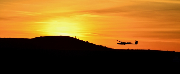 Landing glider in sunset